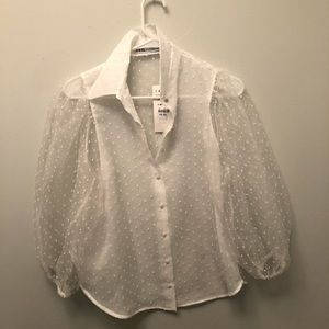 Sheer swiss dot blouse with puffy sleeves